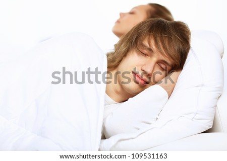 Young man and his wife go to bed - stock photo