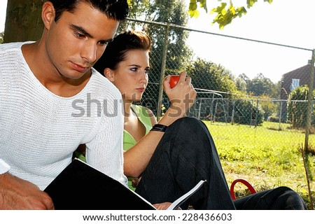 Young man and woman having a break - stock photo