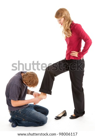 young man and woman, he kneeling before she, white background - stock photo