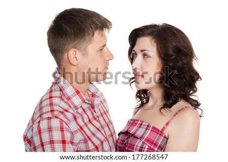 Young man and woman looking at each other isolated on white. - stock photo