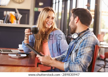 Young man and woman meeting at a coffee shop - stock photo