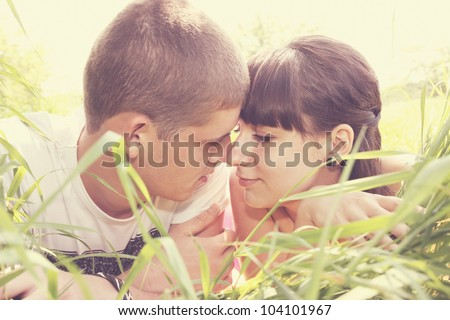 Young man and woman tenderly looking at each other - stock photo