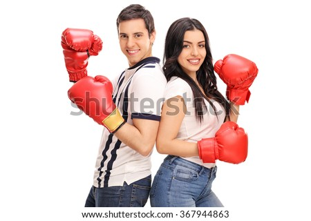 Young man and woman with boxing gloves posing together isolated on white background - stock photo