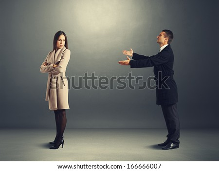 young man apologizing to offended woman  - stock photo