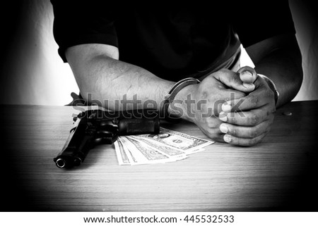 Young man arrested with evidence black and white tone - stock photo