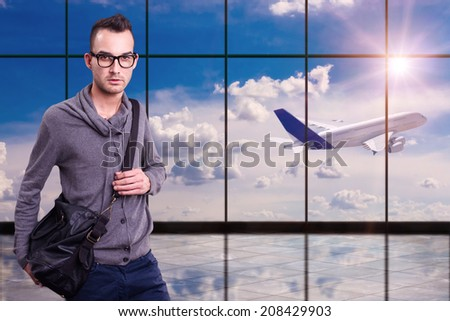 young man at airport, late airplane - stock photo