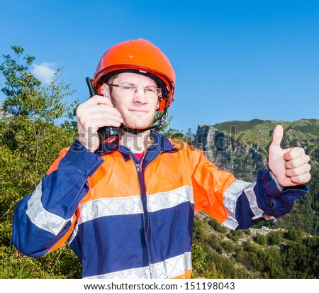 young man at work talks with the radio - stock photo