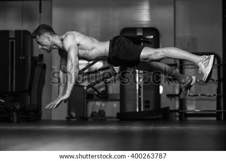 Young Man Athlete Doing Extreme Pushups As Part Of Bodybuilding Training - stock photo