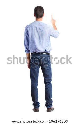 young man back pointing up - stock photo