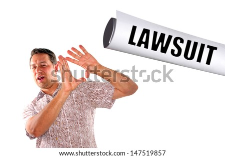 young man being slapped with lawsuit on white background - stock photo