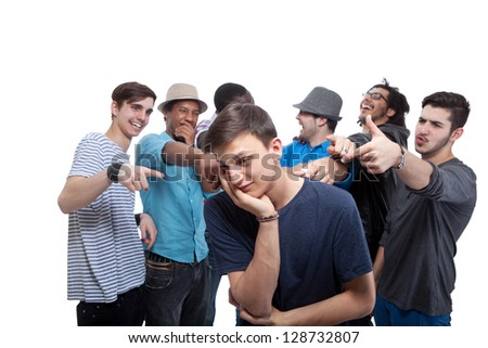 Young Man Blamed By His Friends On White Background - stock photo