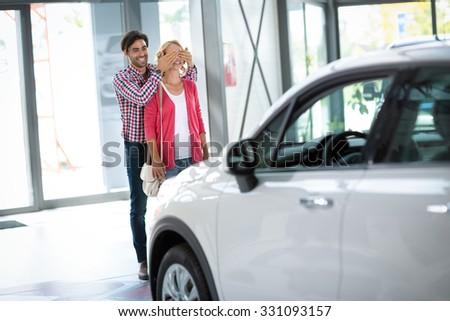 Young man bought his wife a new car, surprised for my love  - stock photo