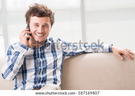 Young man calling on the phone - stock photo
