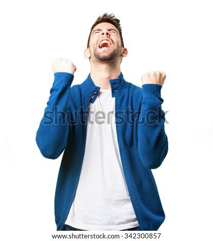 young man celebrating - stock photo