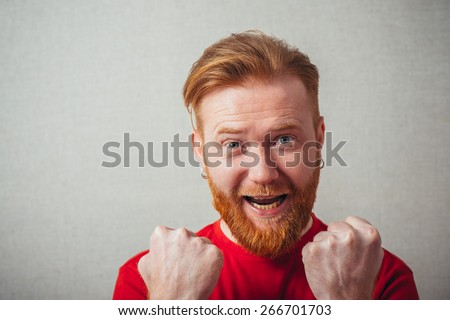 young man celebrating and shouts - stock photo