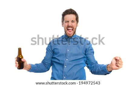 young man celebrating gesture - stock photo
