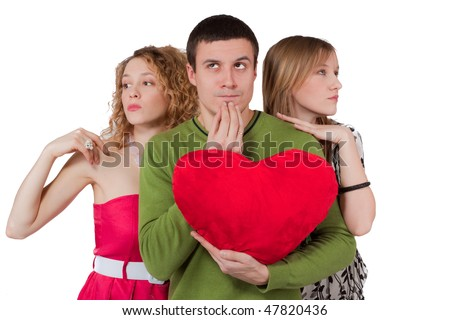 Young man choosing between two women with red heart in hands - stock photo