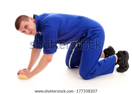 young man cleaning the floor, full lenght, white background - stock photo
