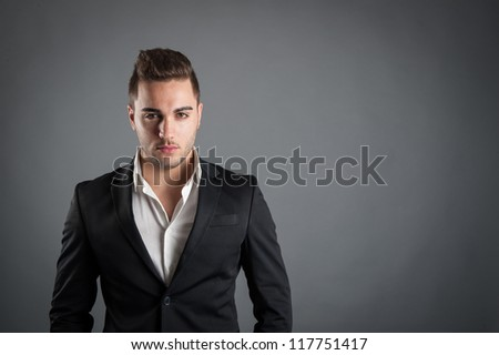 Young man close up portrait against grey background. - stock photo