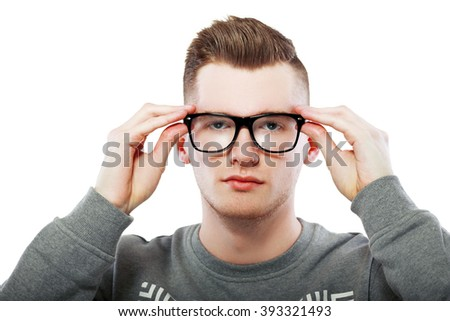 young man close up portrait holding glasses isolated on white - stock photo
