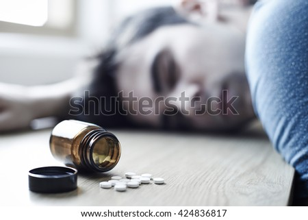 Young Man Commiting Suicide By Overdosing On Medication - stock photo