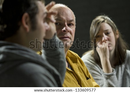 Young man crying from giving his testimony - stock photo