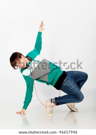 Young man dancing in studio - stock photo