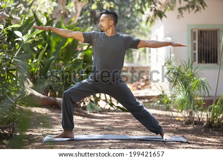 Young man does yoga in nature./Yoga in nature. - stock photo