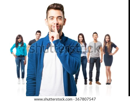 young man doing a silence gesture - stock photo
