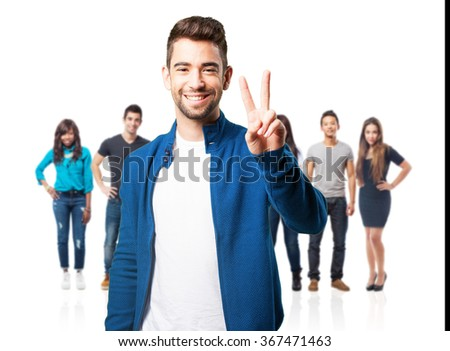 young man doing a victory gesture - stock photo