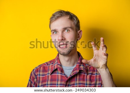 young man doing an aggressive gesture - stock photo