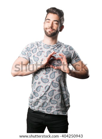 young man doing heart symbol - stock photo
