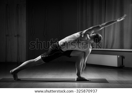 young man doing yoga in the gym - stock photo