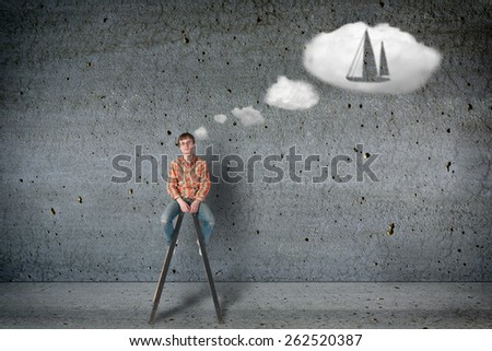 Young man dreams about his own yaht boat - stock photo