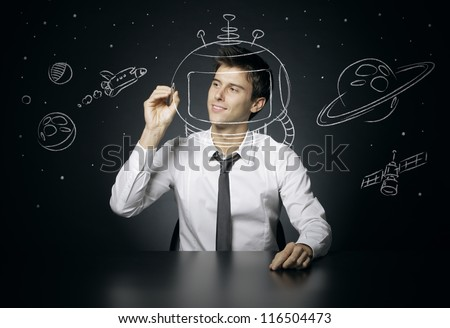 Young man dreams of space travel - stock photo