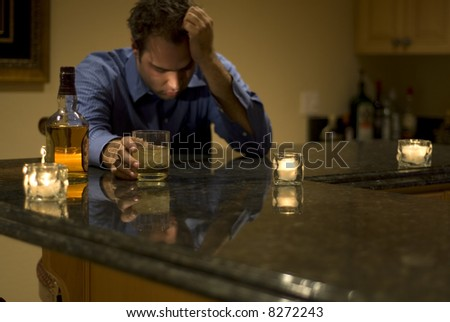 young man drinking and feeling despair - stock photo
