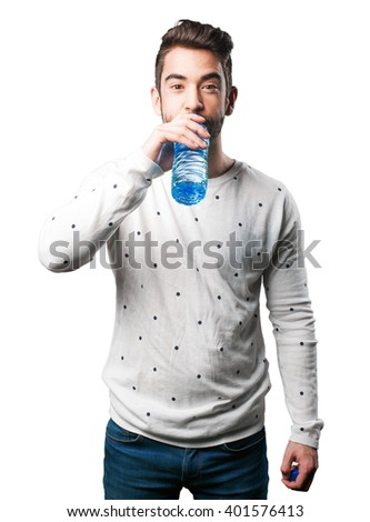 young man drinking water - stock photo
