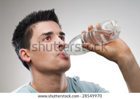 young man drinking water close up shoot - stock photo