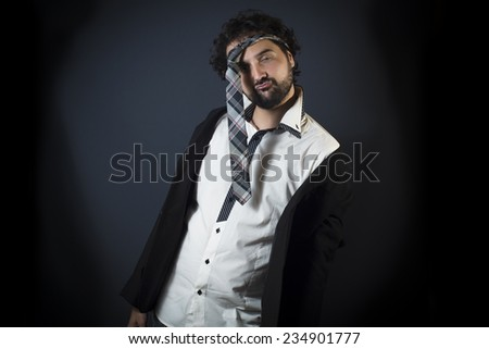Young man drunk with necktie on head - stock photo