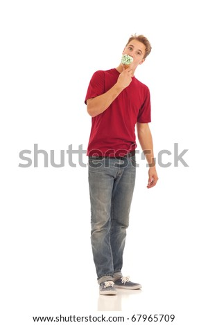 Young man eating ice cream cone - stock photo