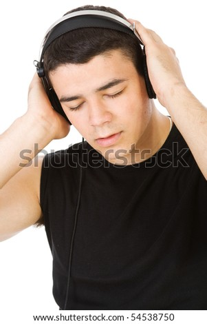 Young man enjoying in music isolate - stock photo