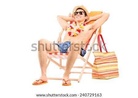 Young man enjoying seated in a sun lounger isolated on white background - stock photo