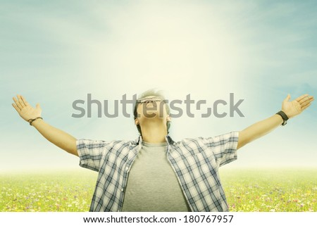 Young man enjoying summer time in the park - stock photo