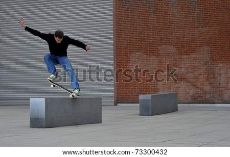 young man enjoys skateboarding in the streets. - stock photo