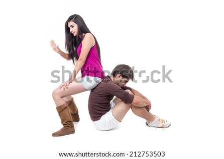 Young man excercising with beautiful personal trainer isolated on white - stock photo
