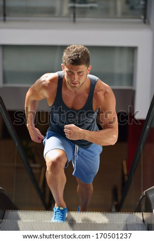 young man exercising in the gym - stock photo