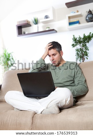Young man experiencing some kind of problem - stock photo