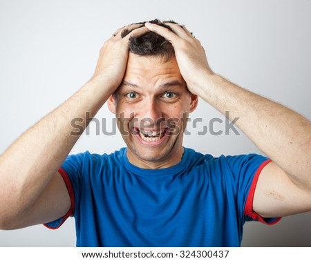 Young man expressing emotions, studi shot - stock photo