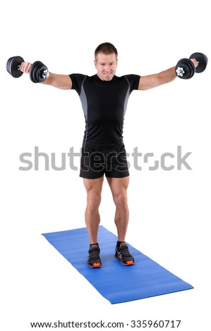 young man fitness instructor shows finishing position of standing dumbbell lateral raise, isolated on white - stock photo