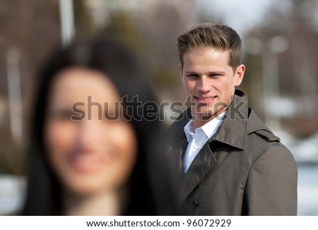 Young man flirting on the street - stock photo